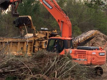 Photo of tree shredding machine used by Green Energy Contracting for a land clearing job